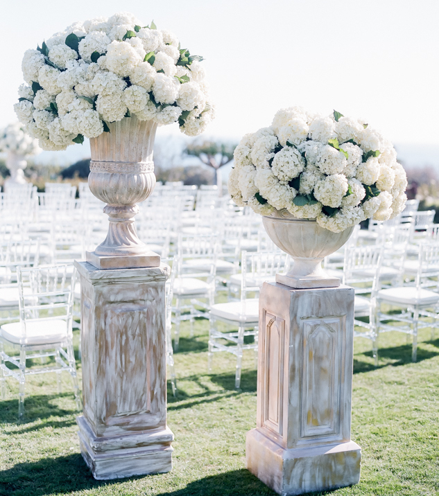 White hydrangea in white washed wedding ceremony