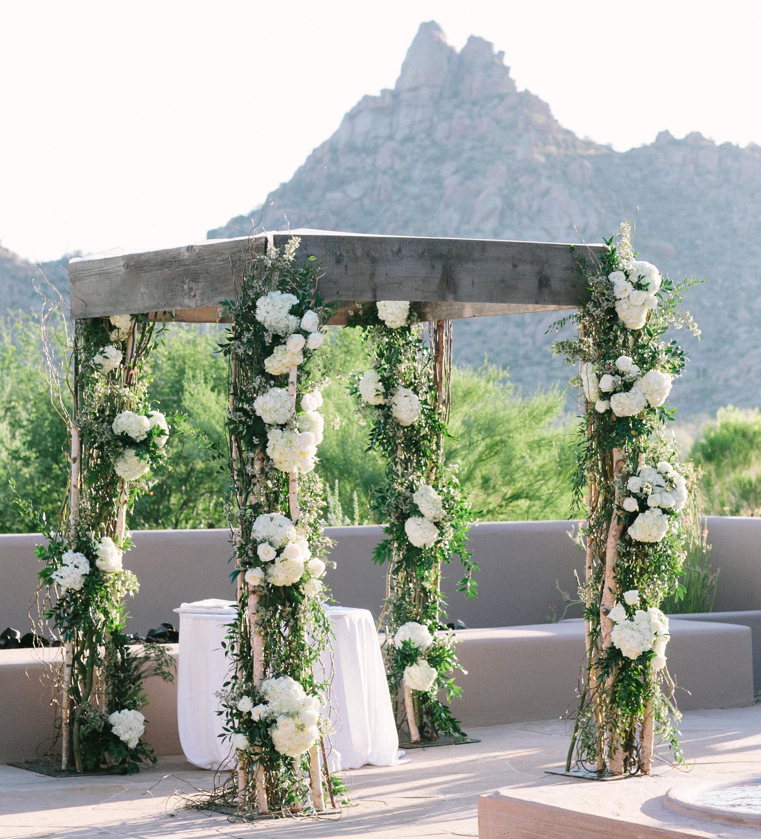 Adrianna Costa wedding rustic ceremony arch