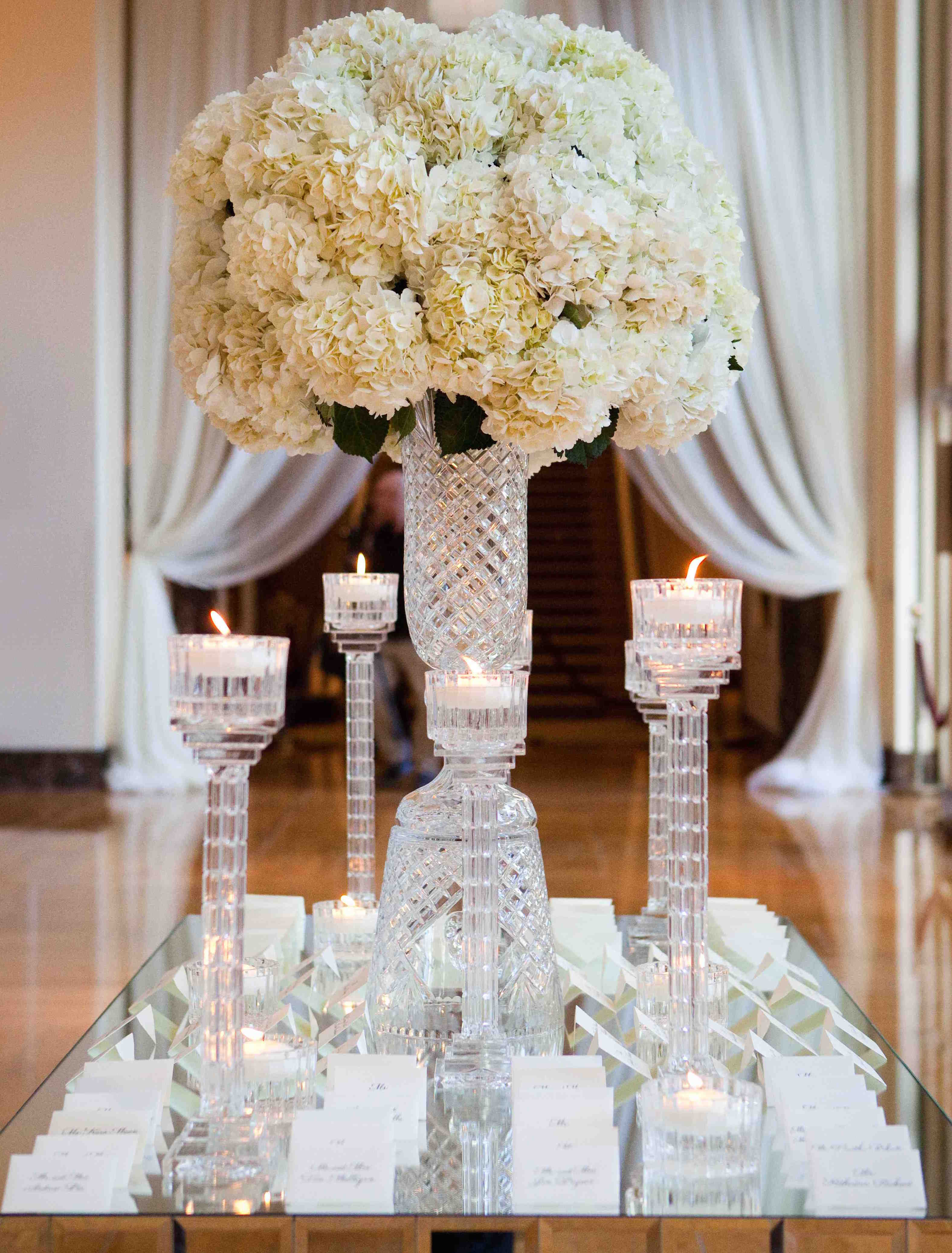 Ivory hydrangea flower arrangement on crystal stand