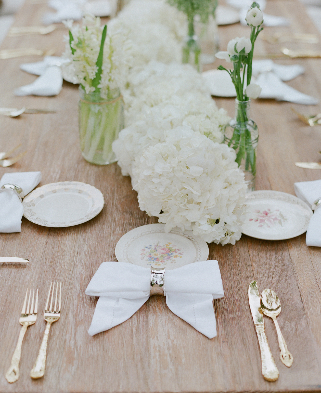 White hydrangea table runner on wood table