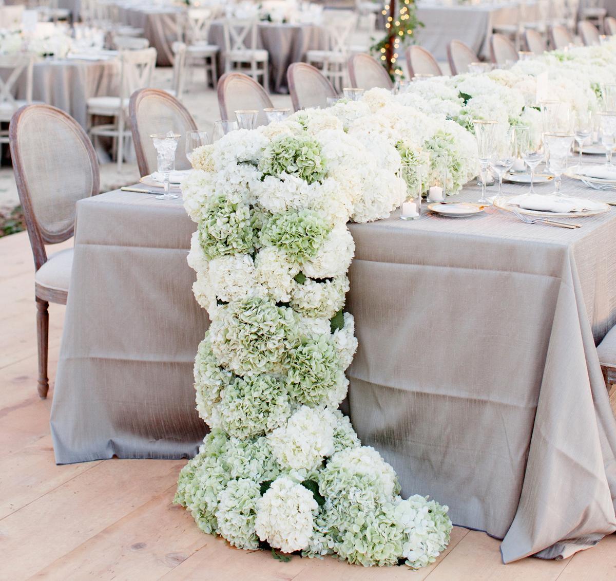 Cascading flower table runner at wedding