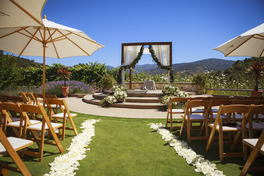 Outdoor Carmel Valley wedding with umbrellas
