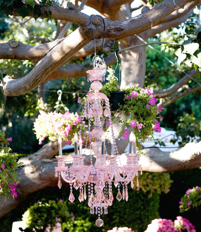 Pink crystal chandelier in tree at wedding