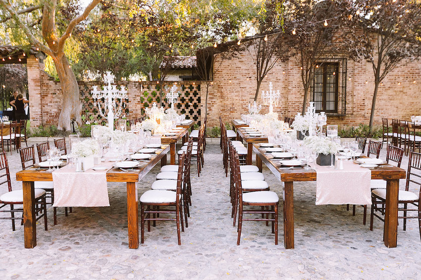 Rustic wedding reception on cobblestone