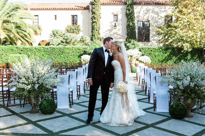 Bride and groom kiss at villa wedding ceremony