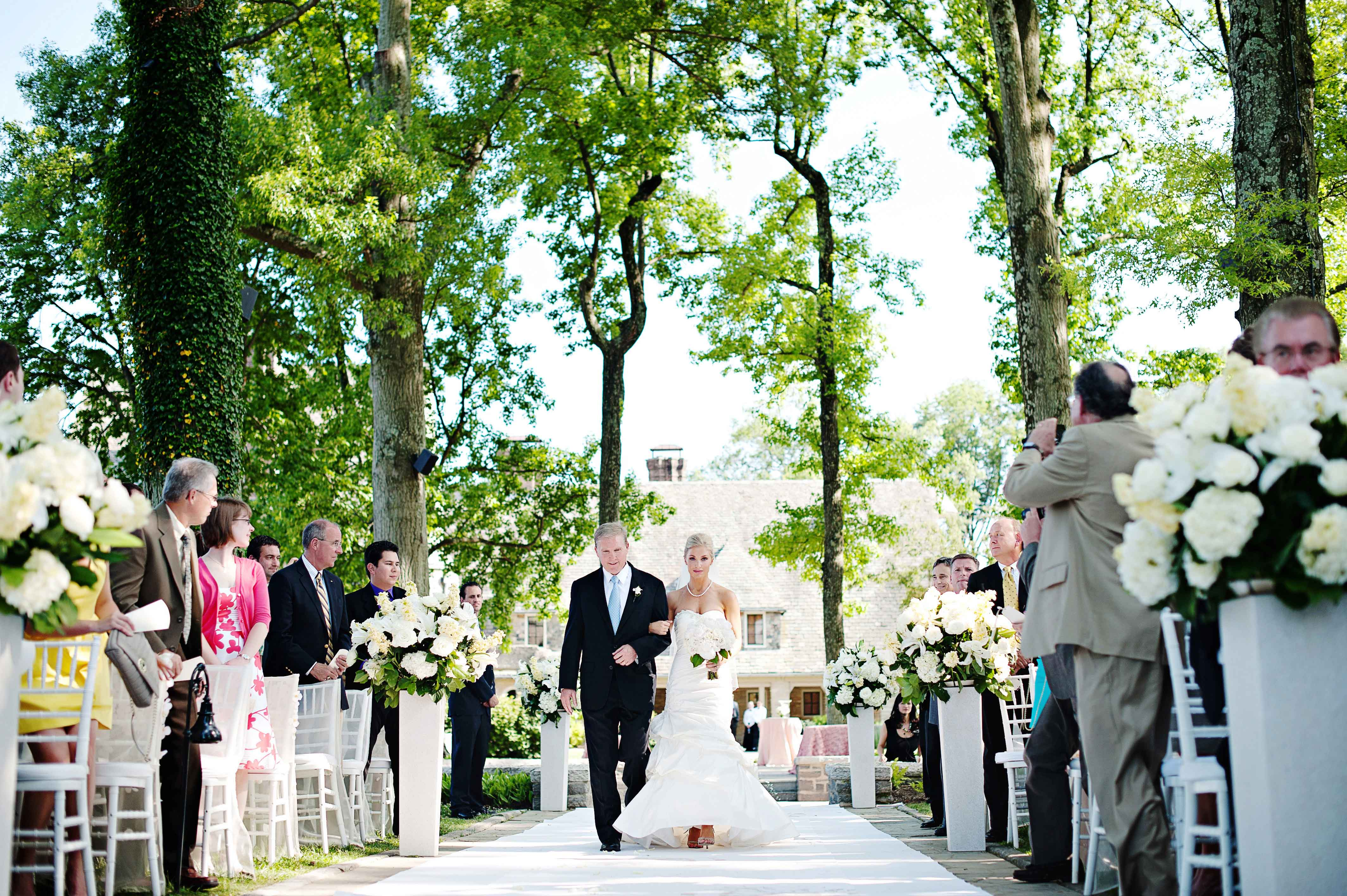 Wedding processional under large tree