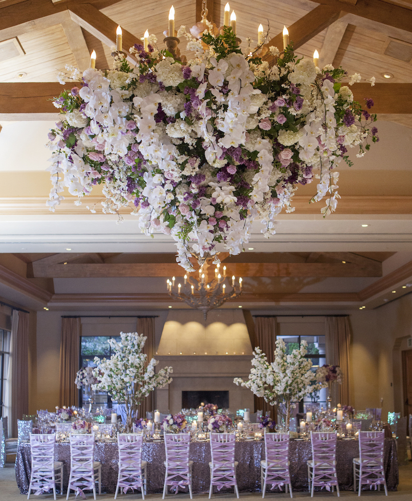 Purple reception with flower chandelier