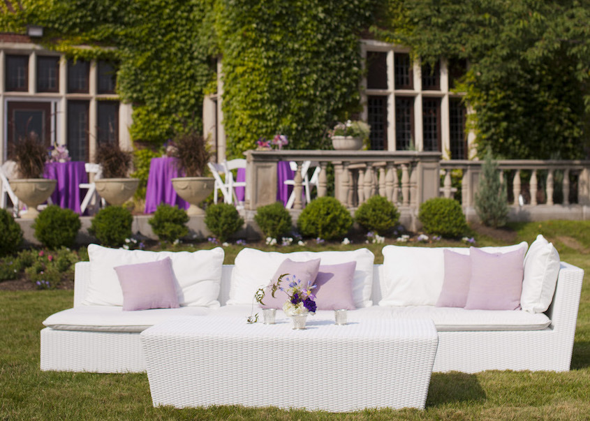 Purple and white outdoor wedding lounge area