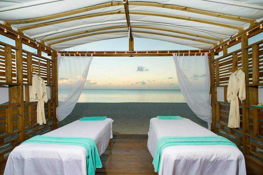 Westin Grand Cayman spa massage table on beach