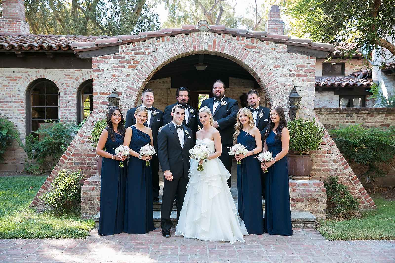 Blue Bridesmaid Dresses and Tuxedo Groomsmen