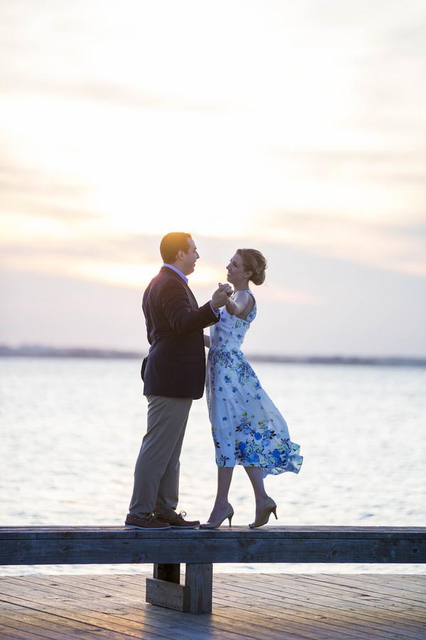 Sunset engagement shoot on edge of pier