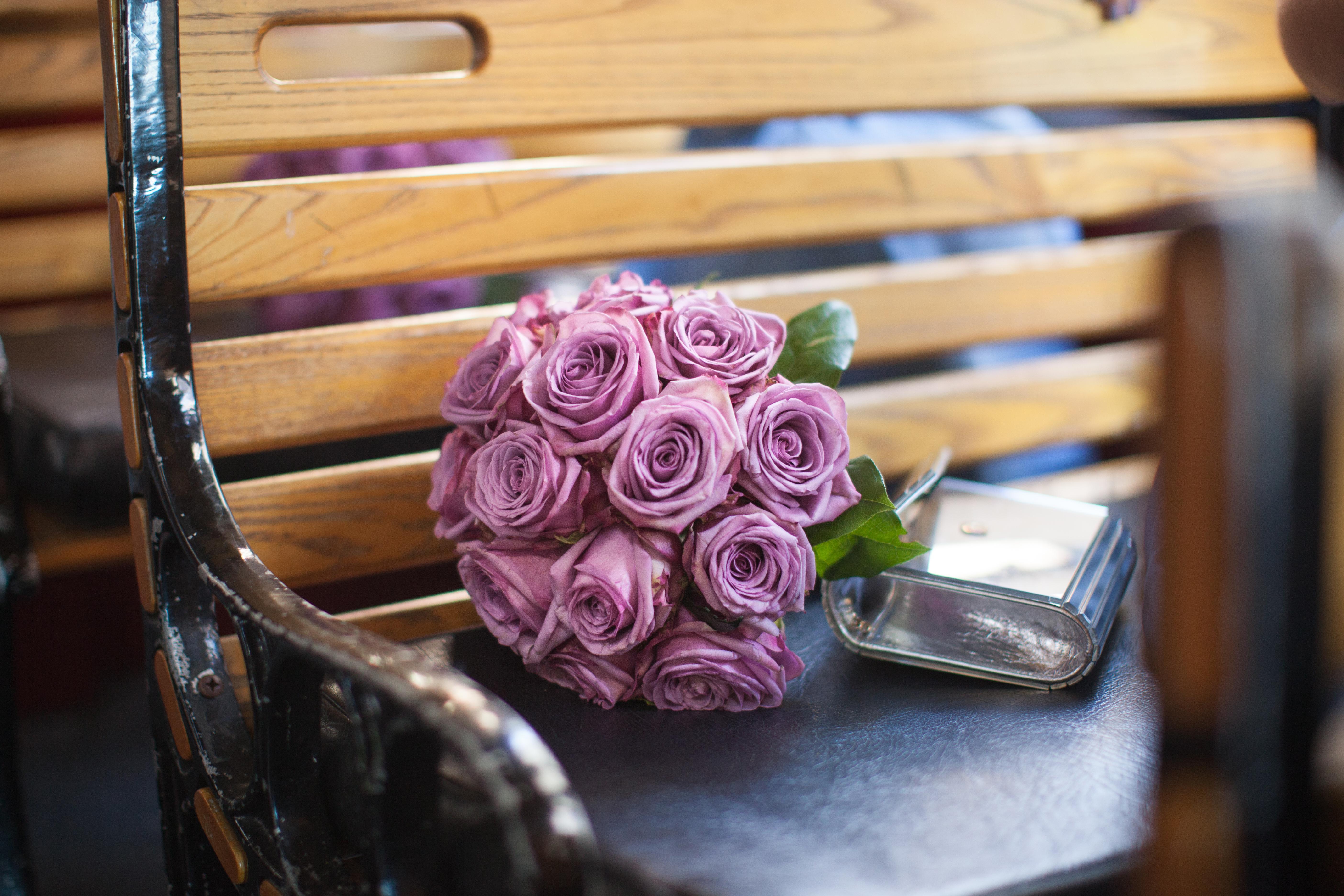 Purple rose bouquet on bench