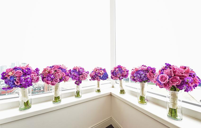 Purple bridesmaid bouquets in window