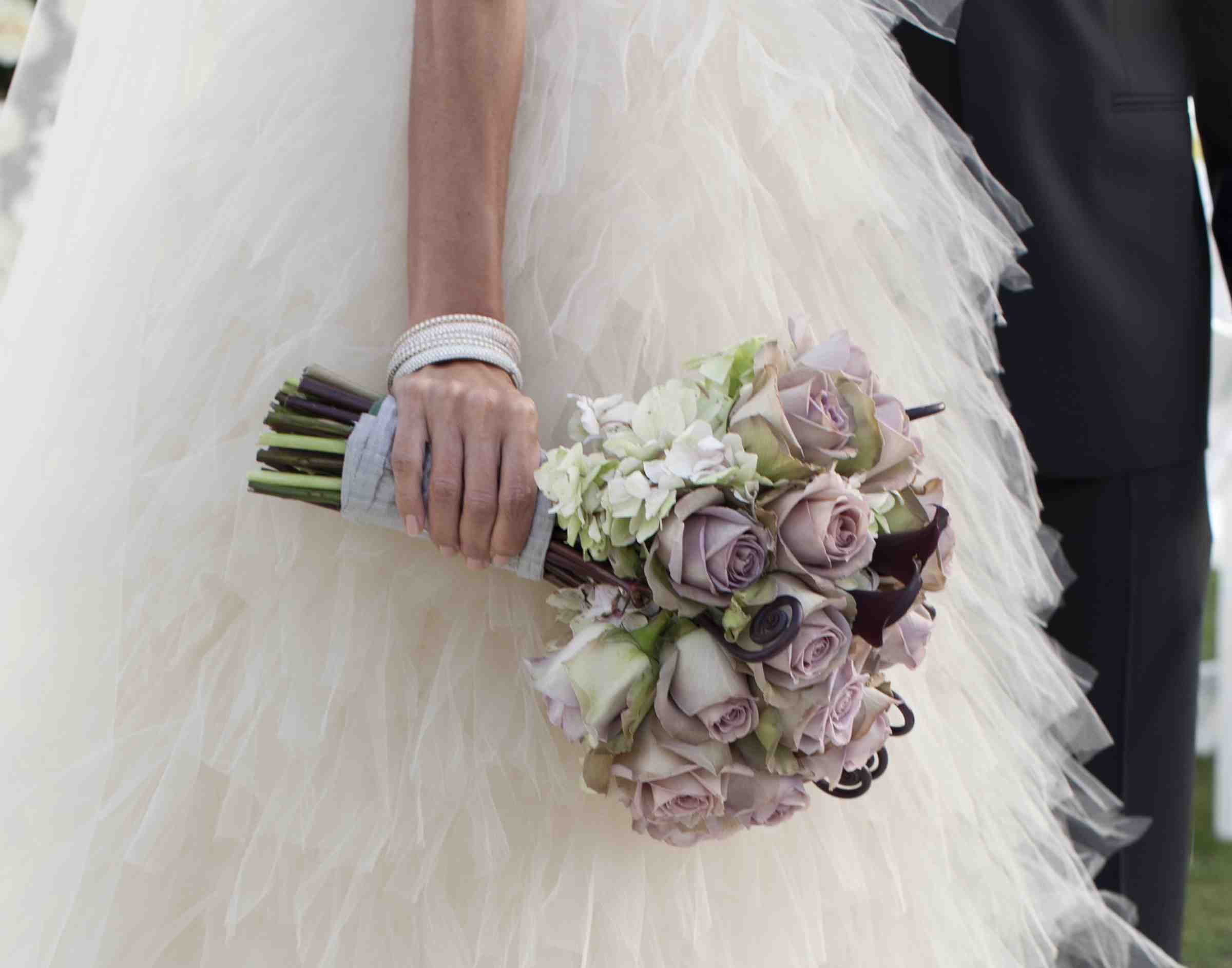 Bride holding lavender wedding bouquet