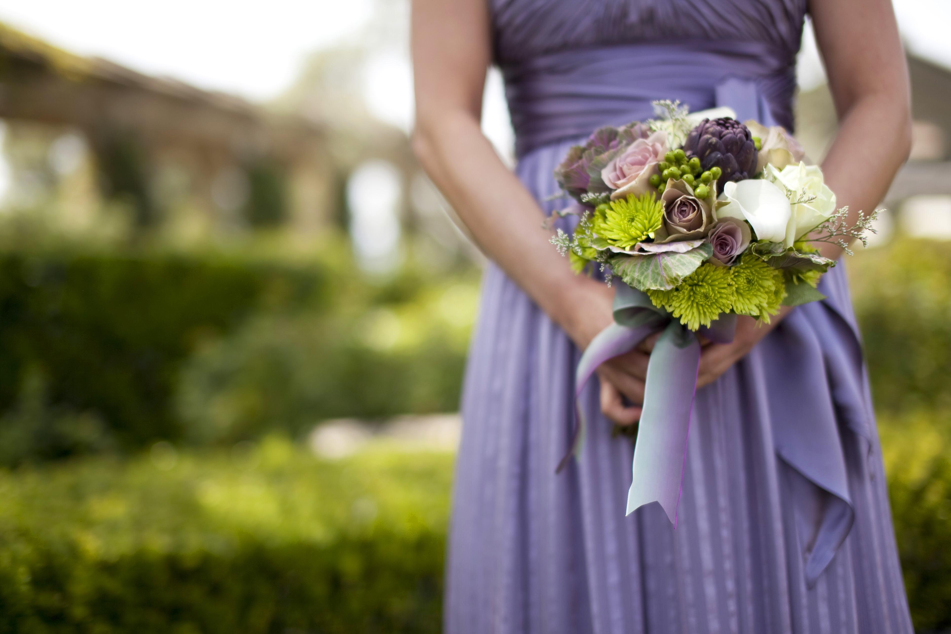 Purple artichoke in bridesmaid bouquet