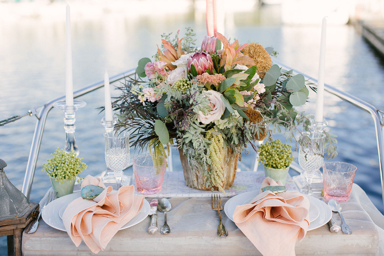 Rustic protea wedding centerpiece on sailboat for photo shoot