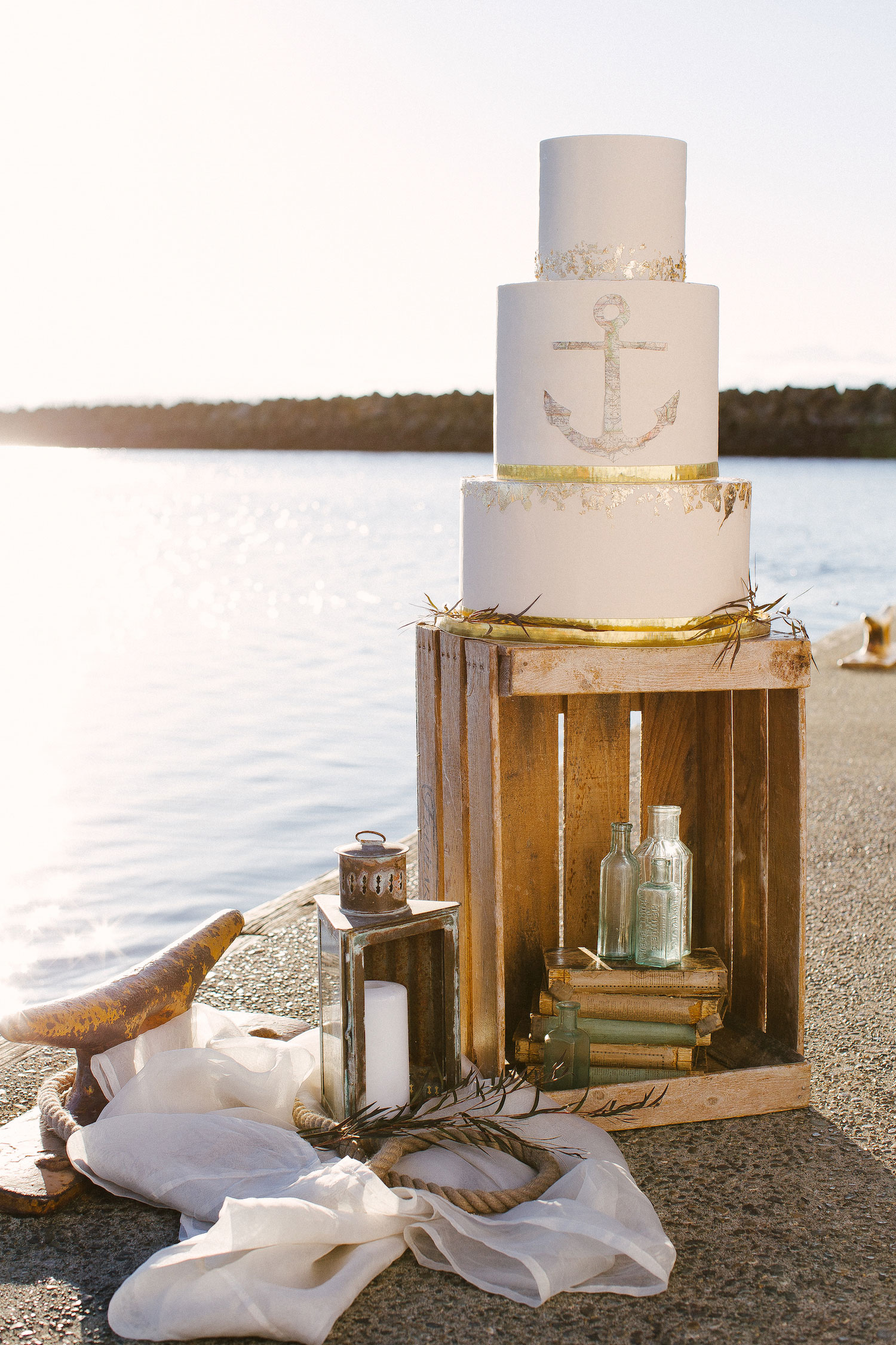 Nautical wedding cake with gold anchor