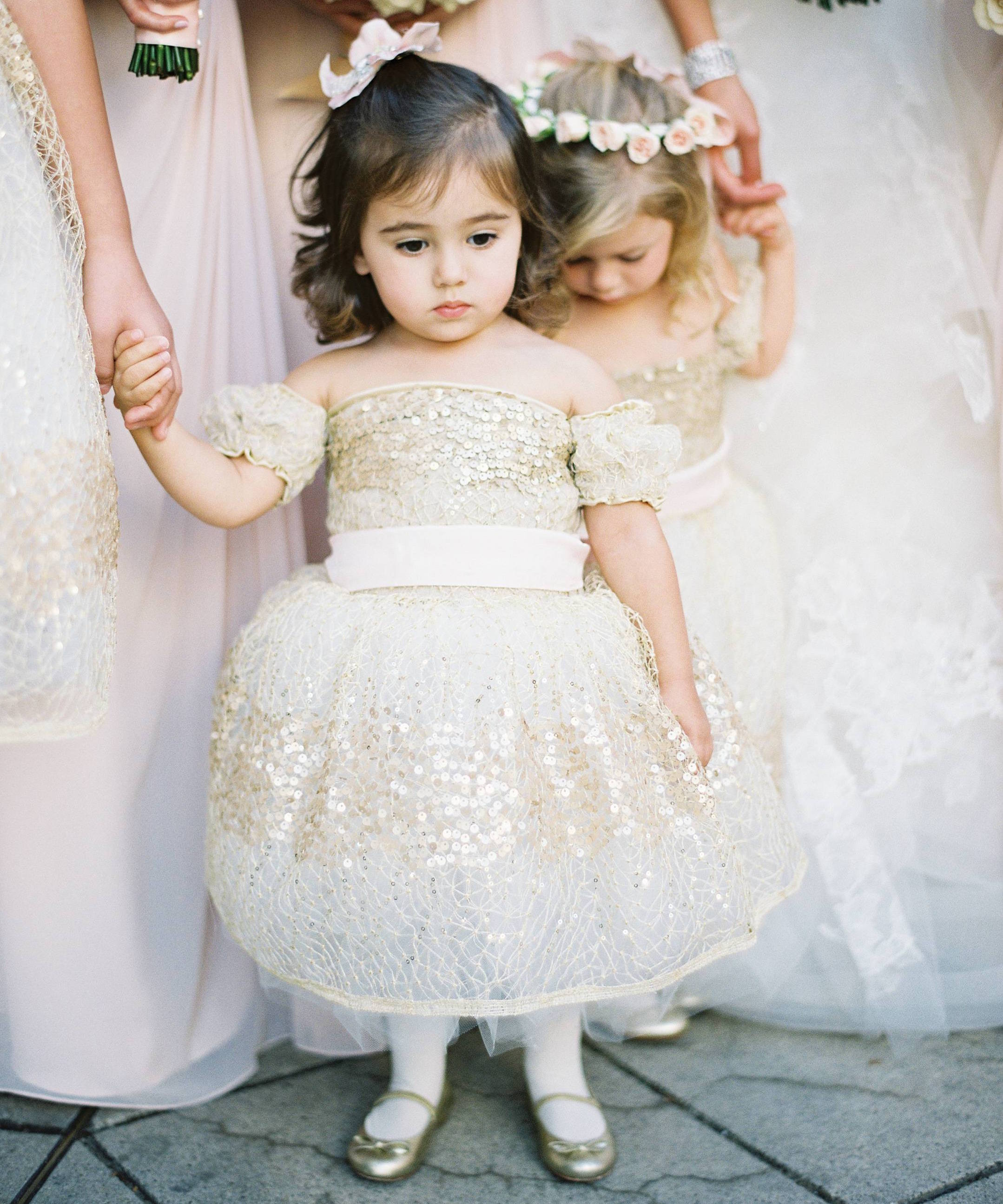 Flower girl in gold sequin dress