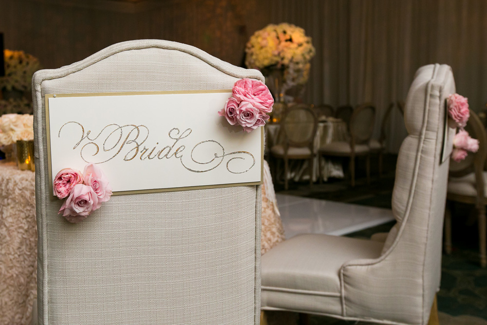 glitter and flower bride sign on chair