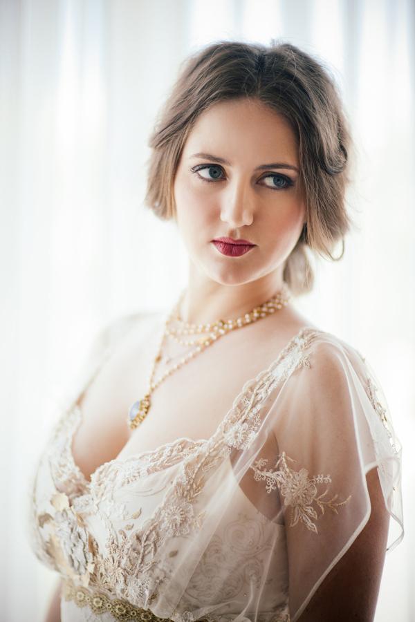 Bride with red lipstick and Claire Pettibone dress