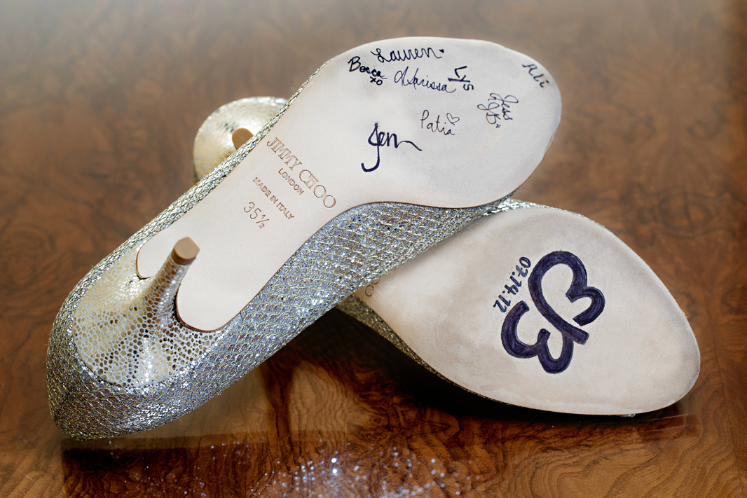 silver bridal shoes signed by bridesmaids