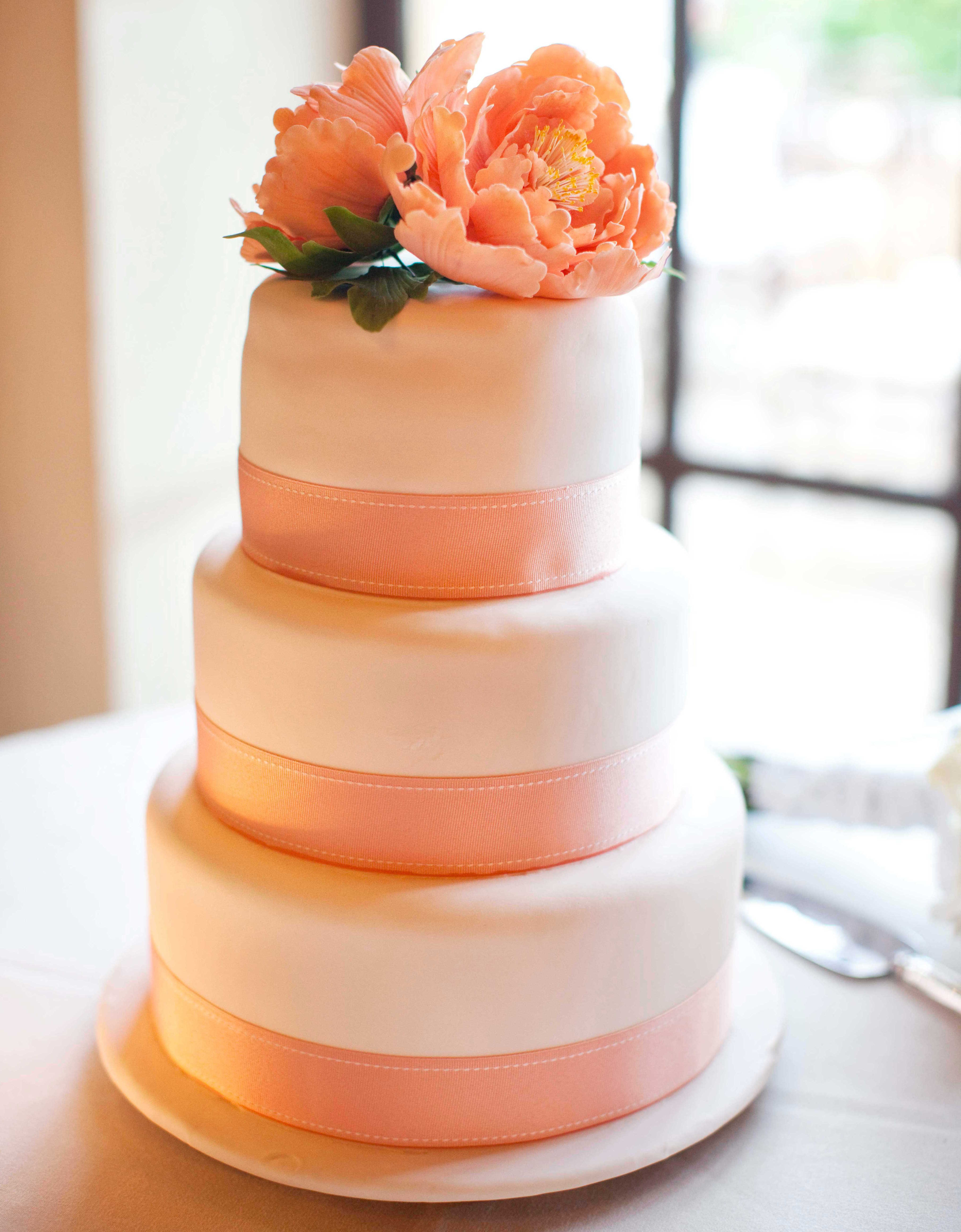 White small wedding cake with pink ribbons