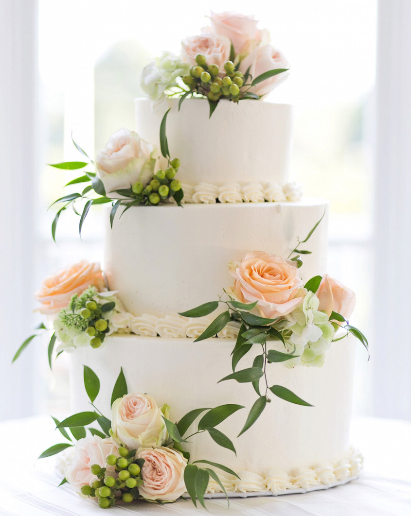 Small three layer wedding cake with flowers