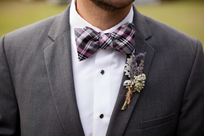 Lavender groom's wedding boutonniere