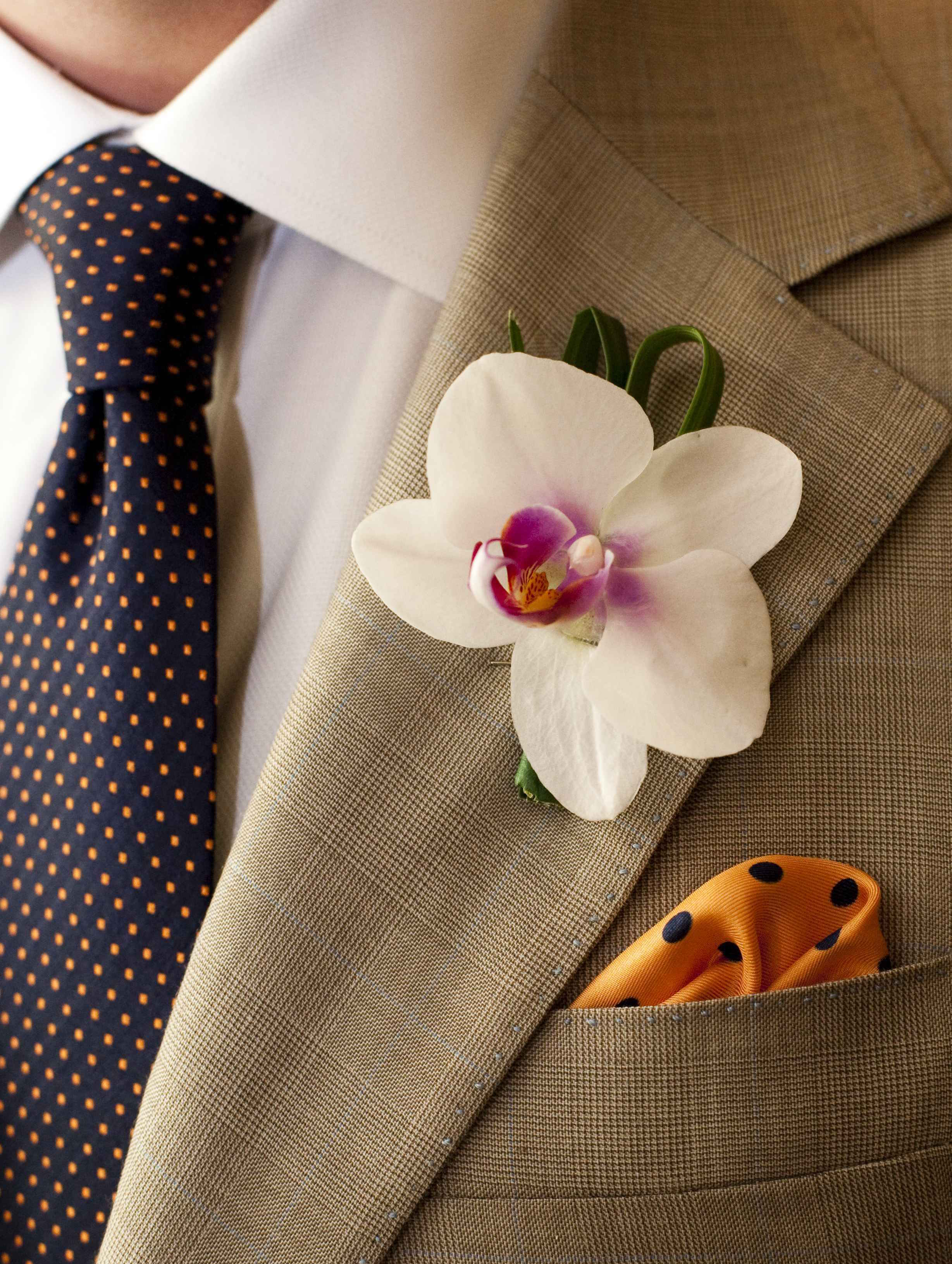 White orchid Costa Rica wedding boutonniere