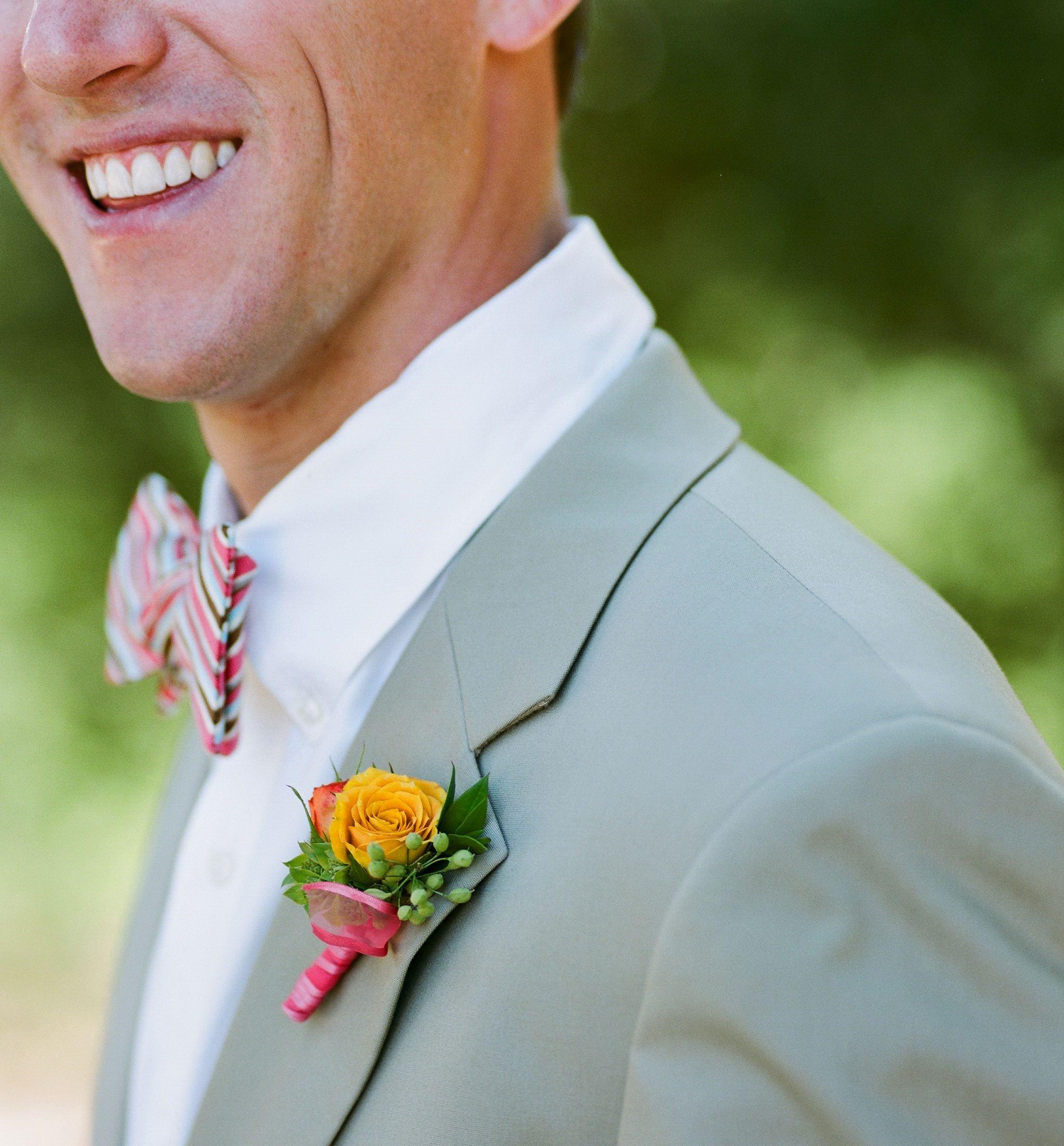 Bright orange wedding boutonniere