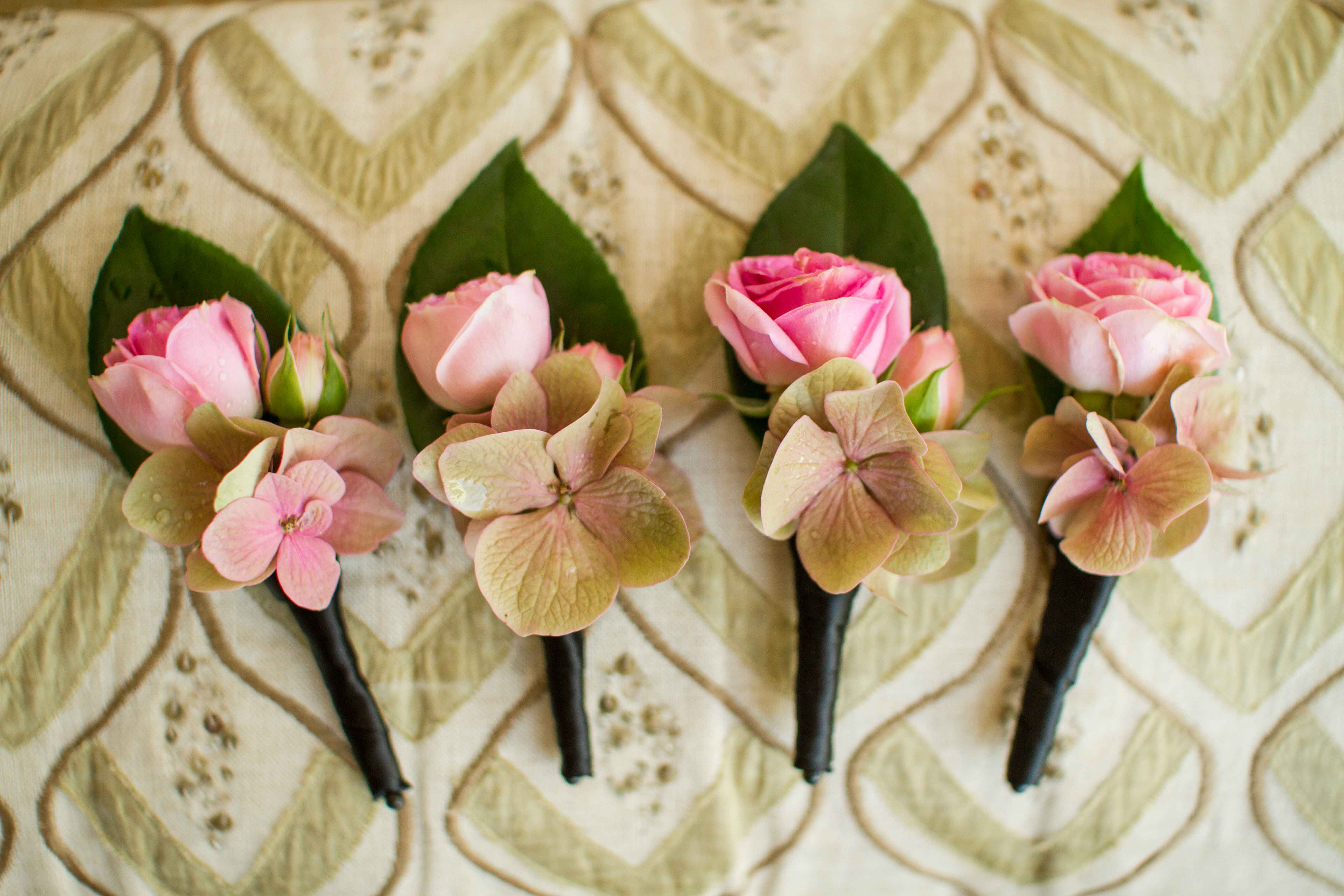 Pink rose boutonniere with hydrangea floret