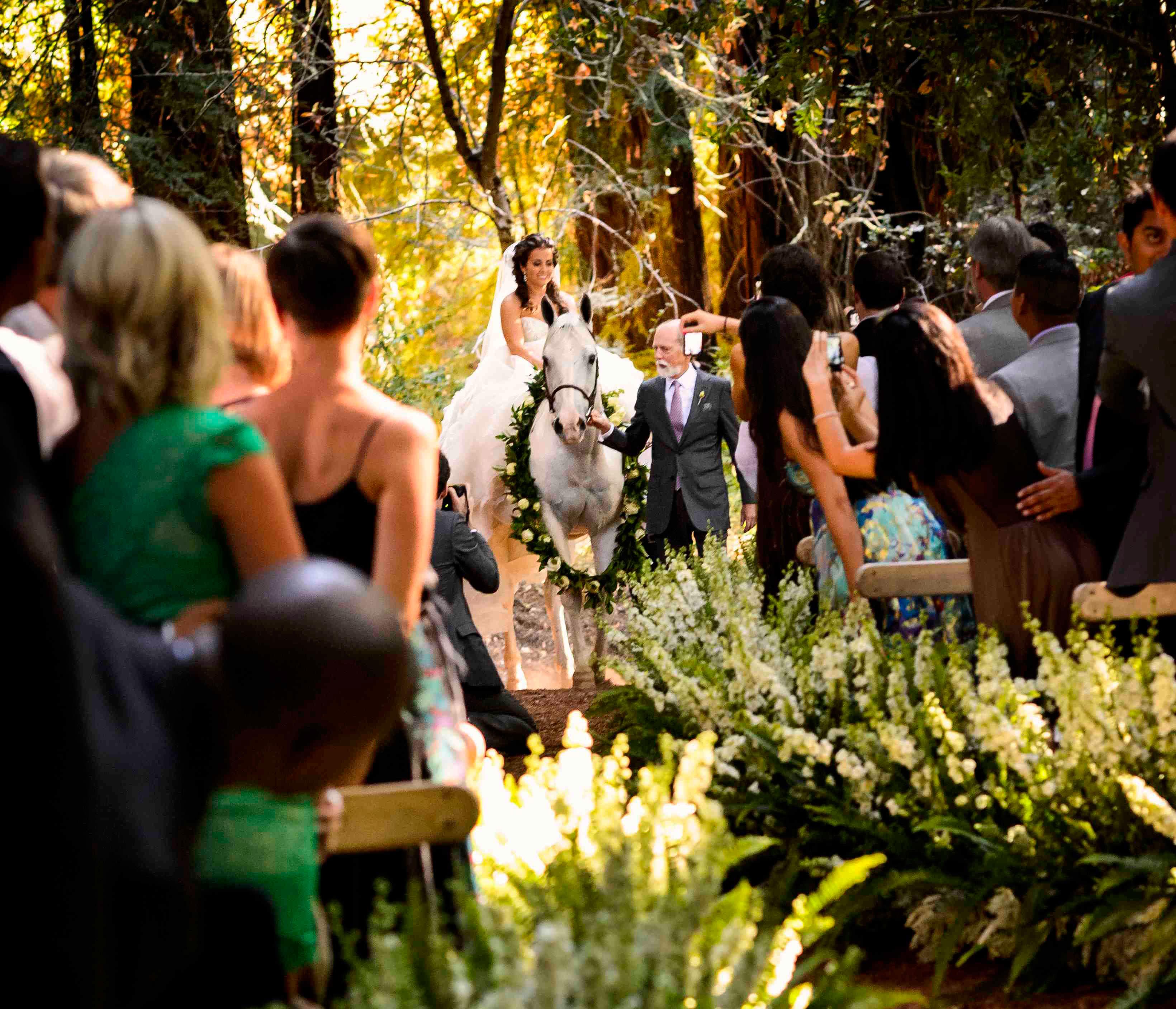 Bride escorted to ceremony on horseback