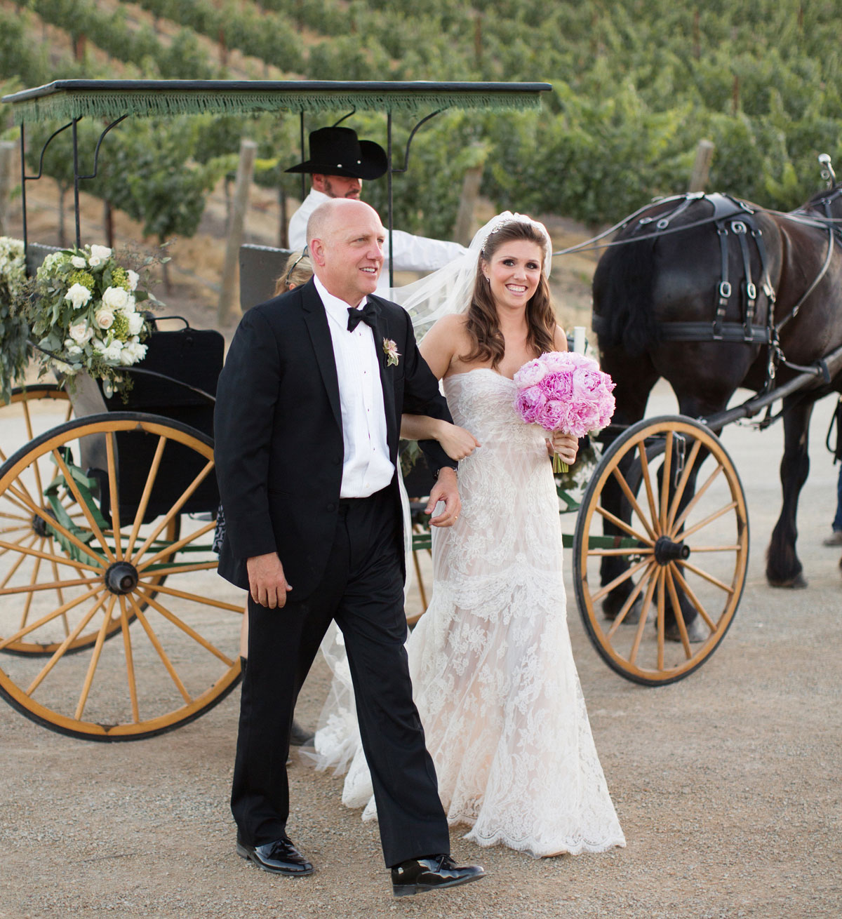 Bride escorted off of horse drawn carriage