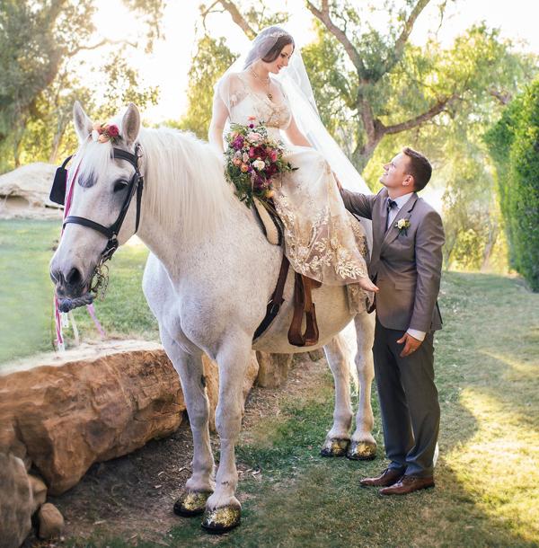 Bride in Claire Pettibone dress on horse