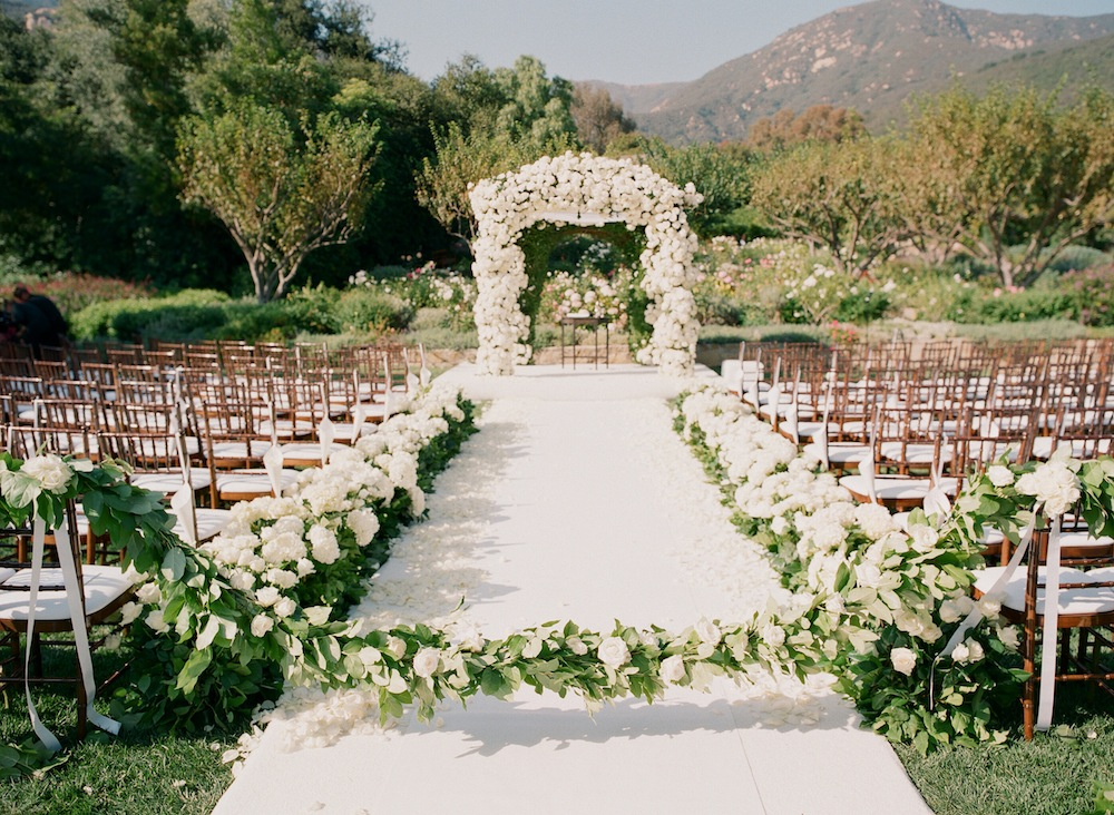 Outdoor ranch wedding with white flowers