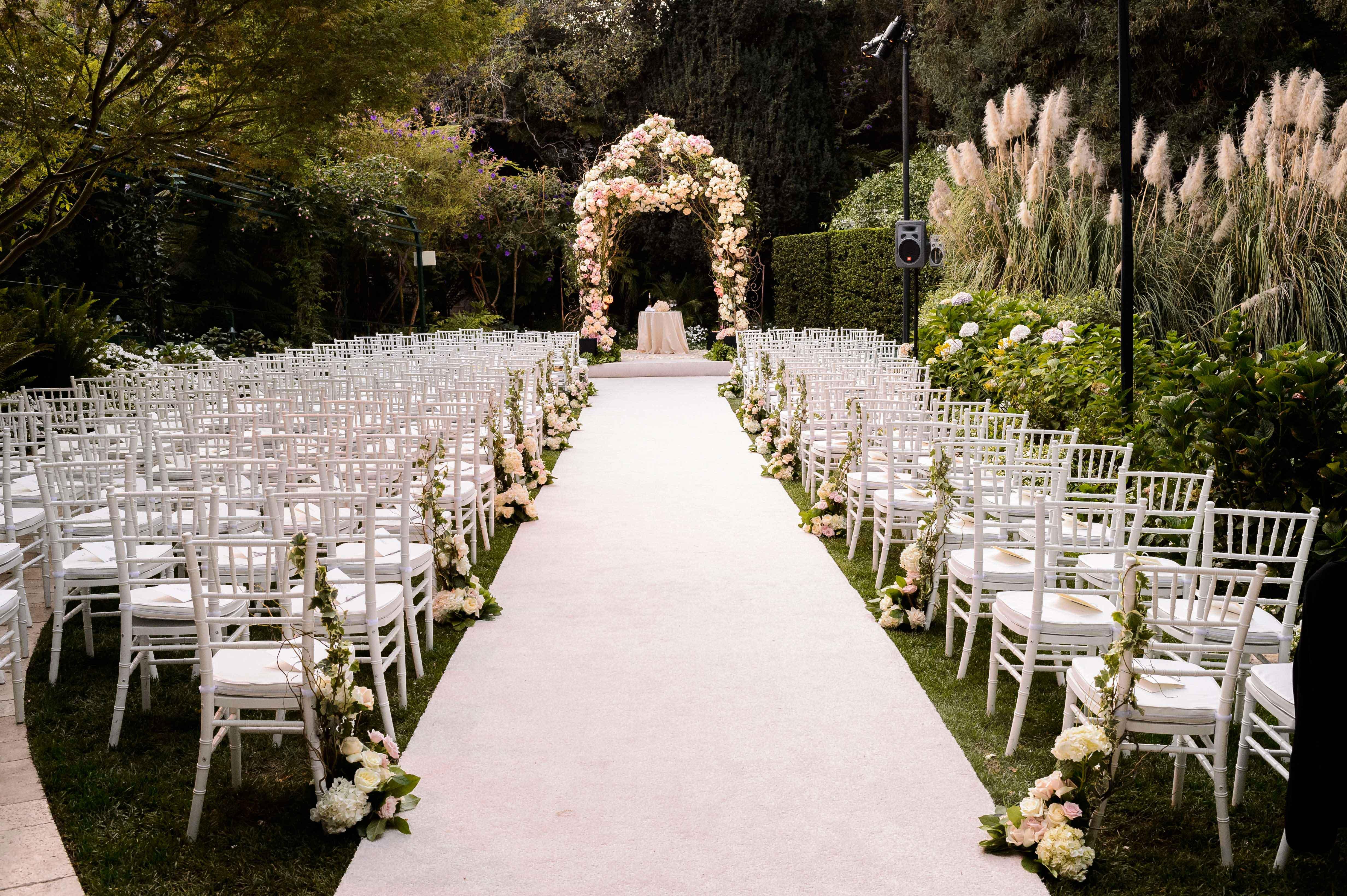 Garden wedding ceremony with flower chuppah