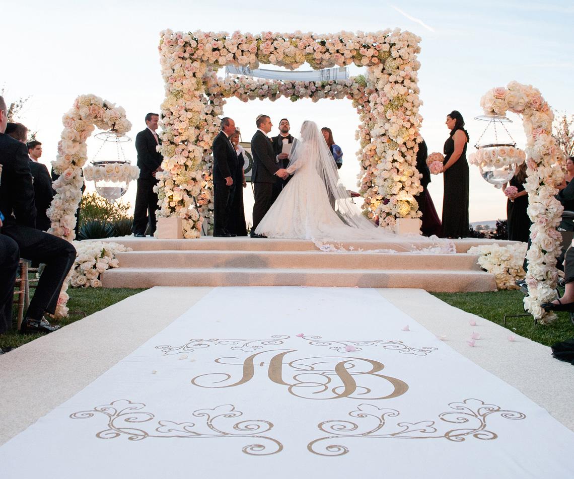 Wedding ceremony with custom aisle runner