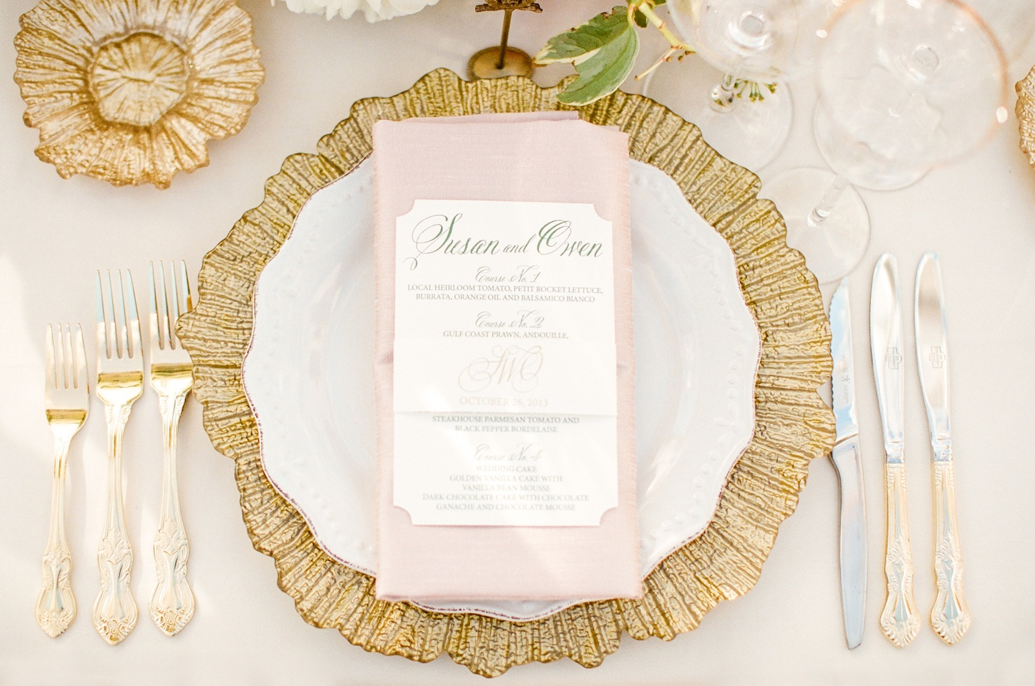 Gold texture charger with gold flatware at wedding