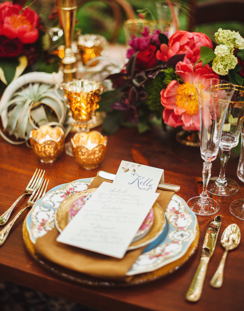 Colorful wedding china and gold flatware