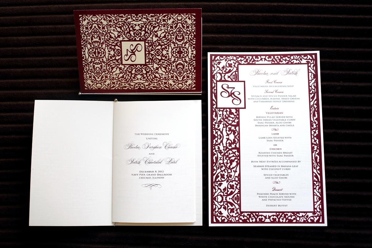 red laser cut wedding invitation