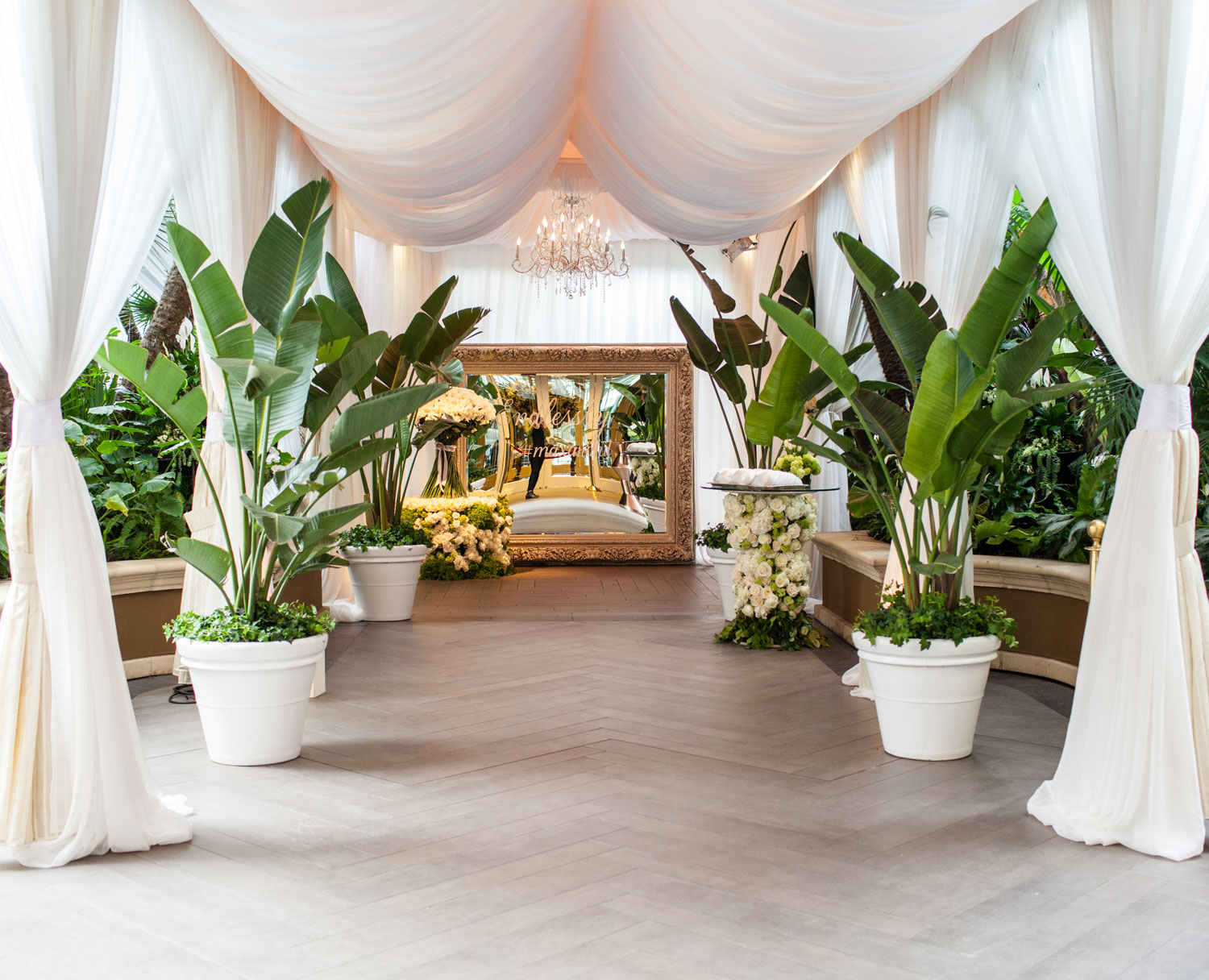 Palm tree wedding entrance and mirror sign