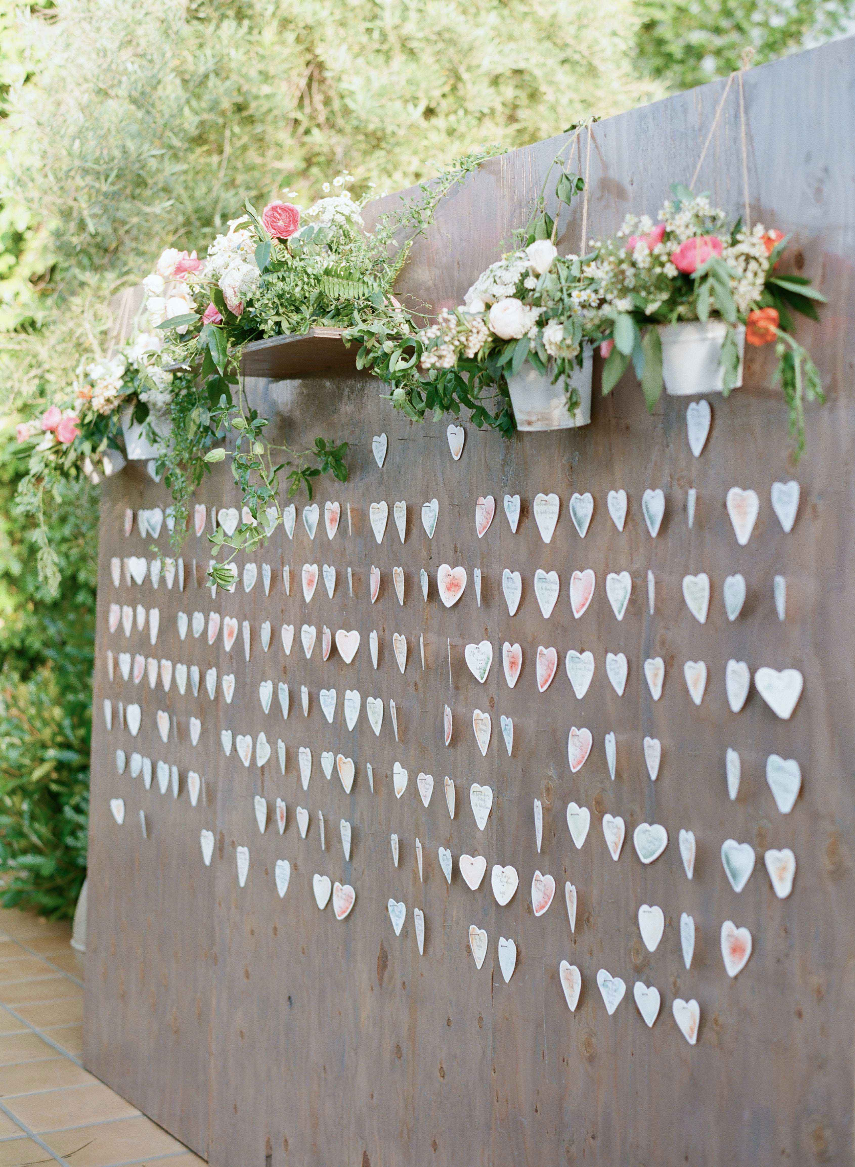 Freestanding wood wall with heart escort cards
