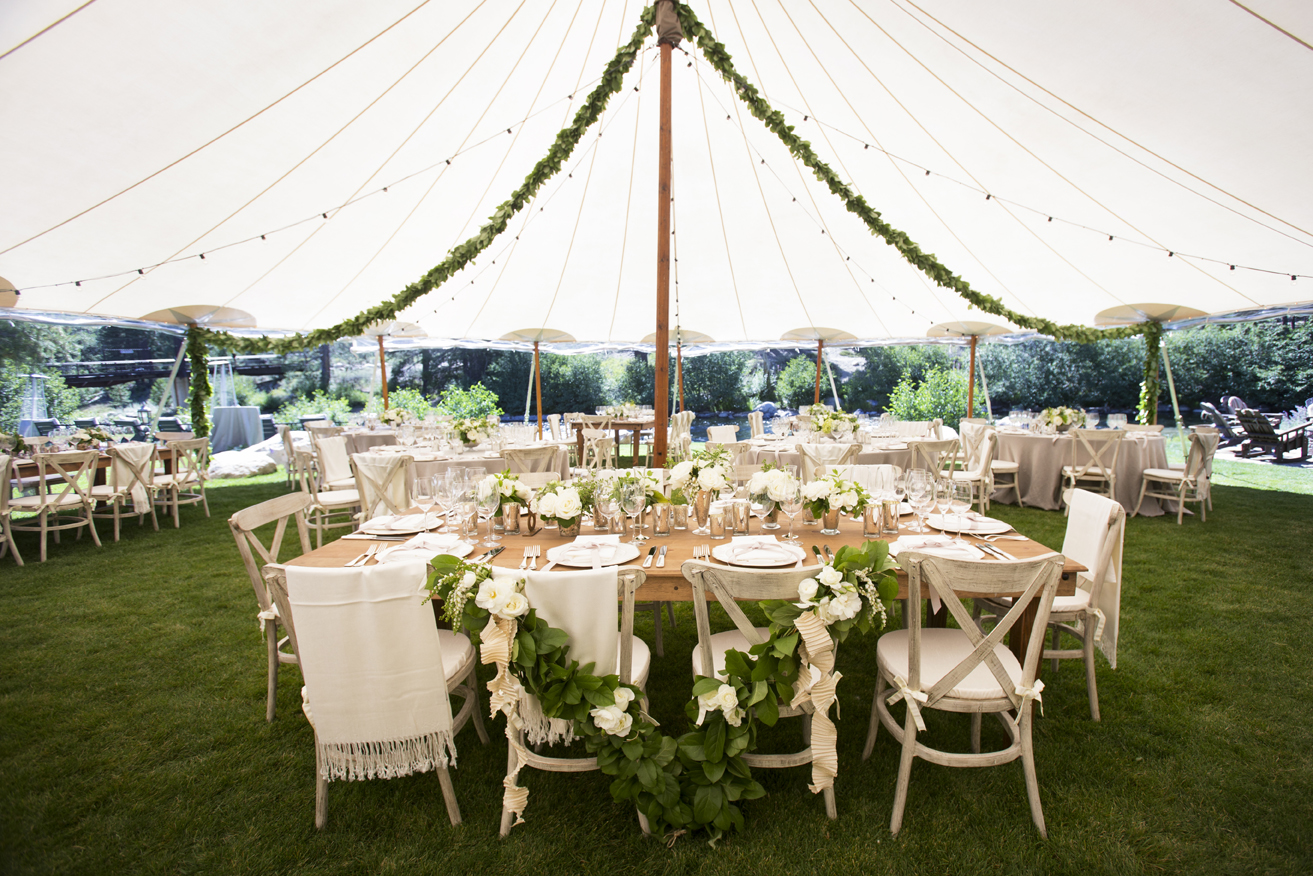Green garlands on bride and groom chairs