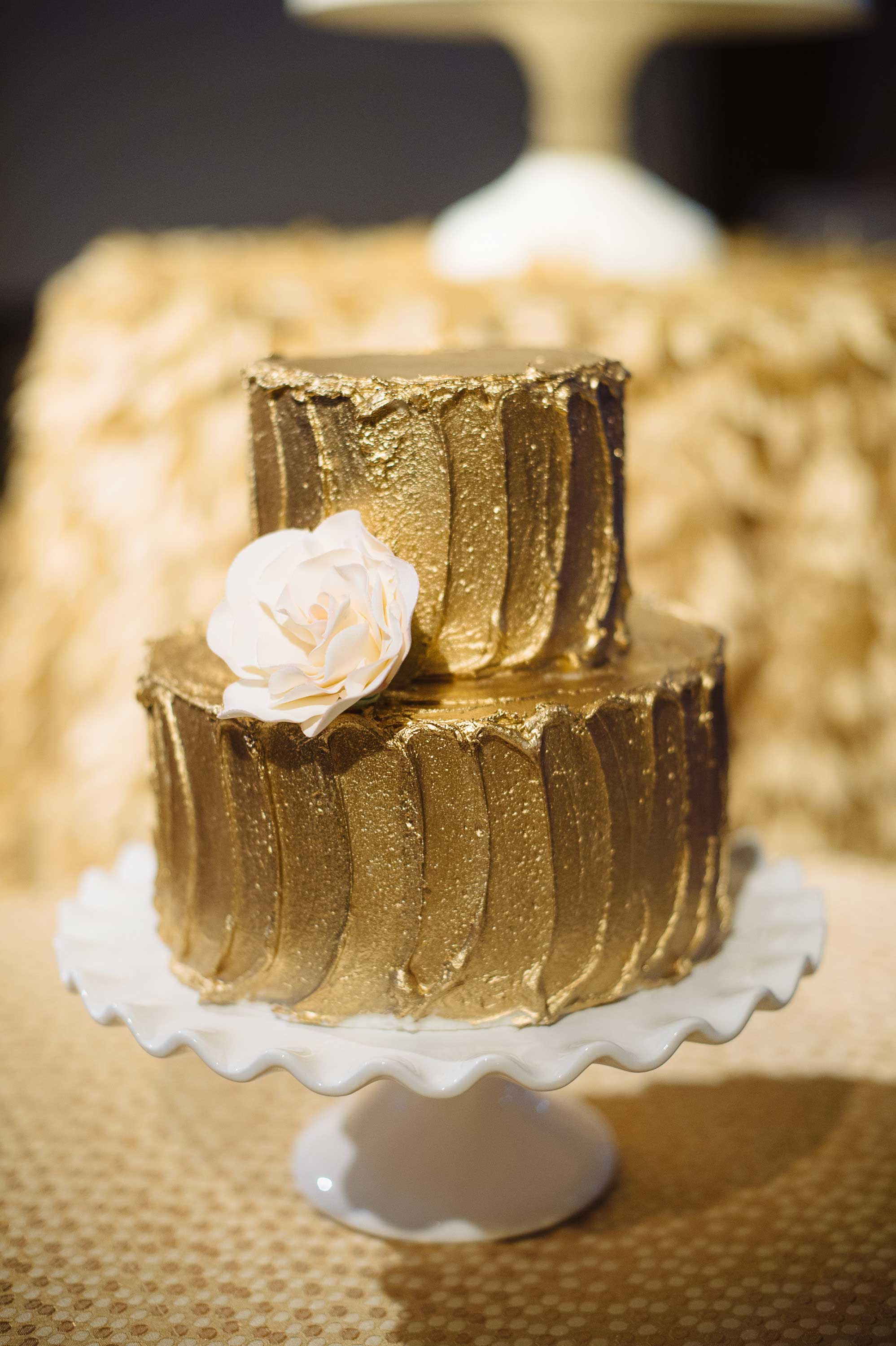 Two layer wedding cake with gold frosting