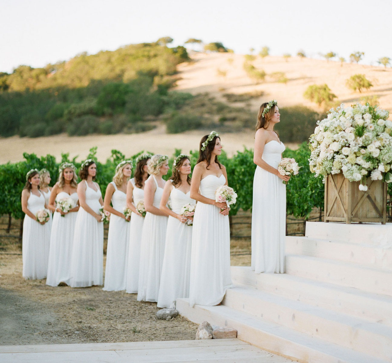 Bridesmaids at ceremony different dresses same color white