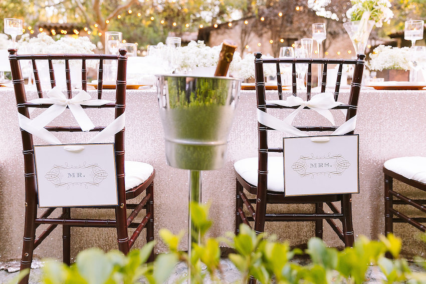 Ribbons on back of bride and groom chairs