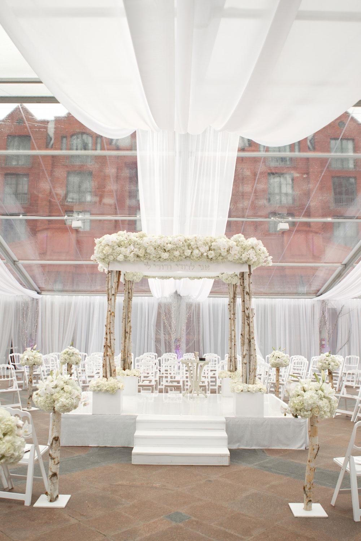 White winter wedding with birch tree arch