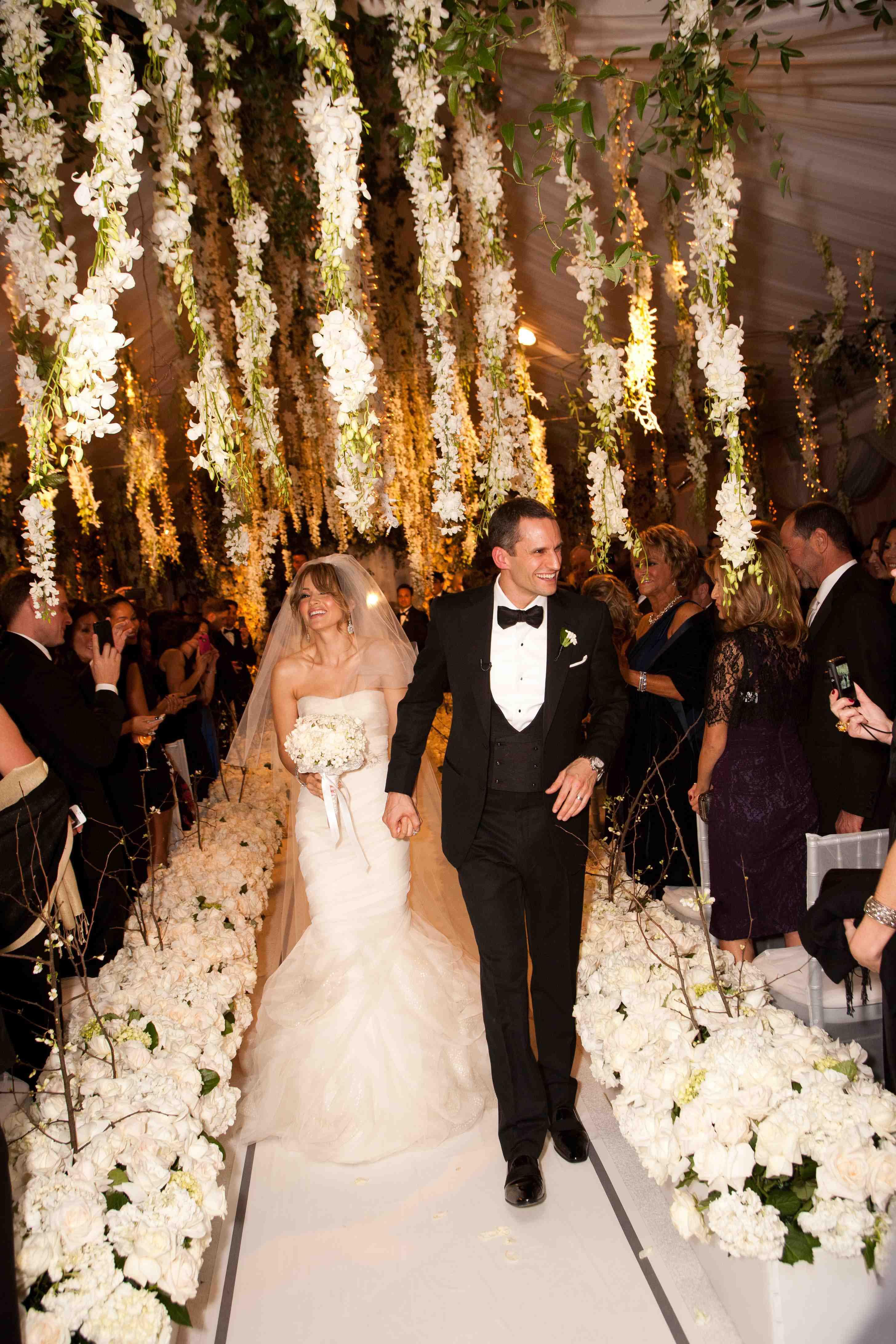 White tree branch wedding ceremony decor