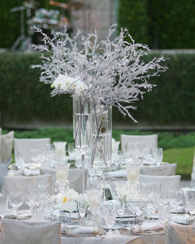 Icy tree branch winter wedding centerpiece