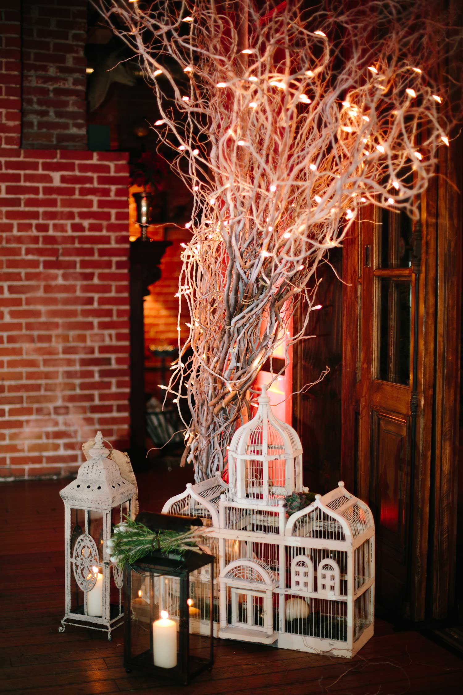 White tree branch with Moroccan lanterns